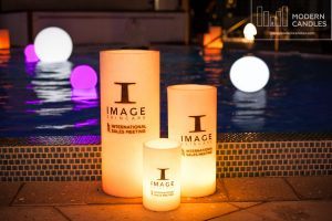 Large candles and LED glow spheres in the pool